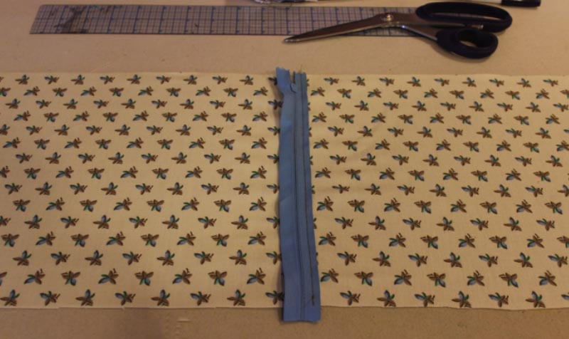 Cut a piece of lining fabric 63.5cm x 25.5cm and with the right side uppermost draw a line 35cm in from the left hand side