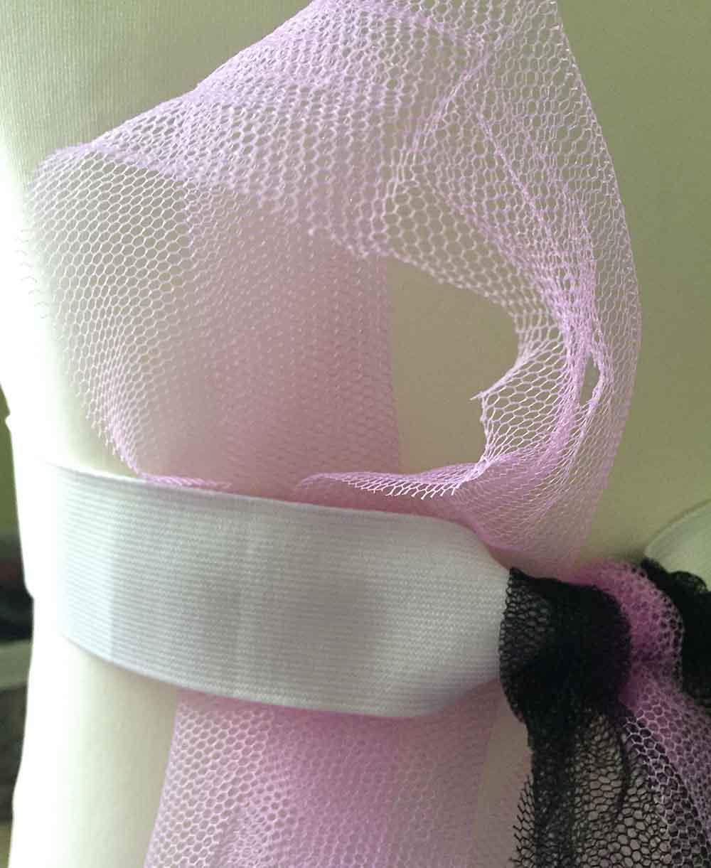 Fold each strip of dress net in half